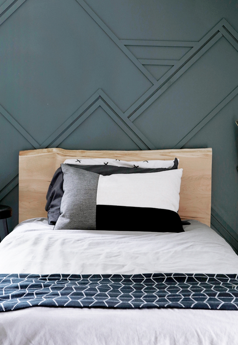 wood bed against blue wall