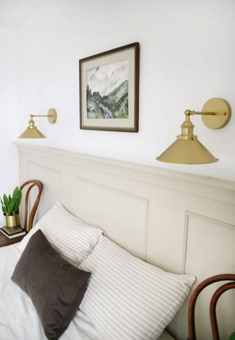 gold wall sconces on painted feature wall