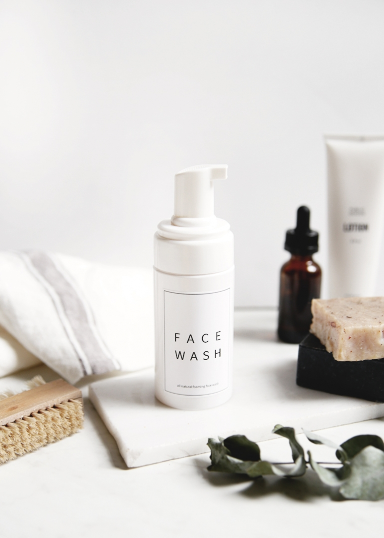 bottle of face wash styled with bathroom products