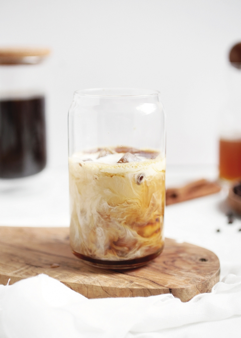 glass of iced coffee swirled with milk
