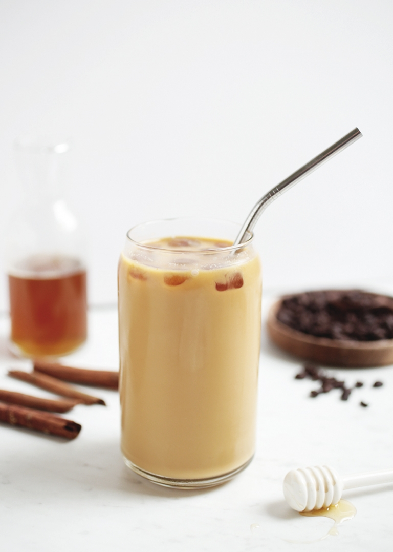 glass of iced coffee with metal straw