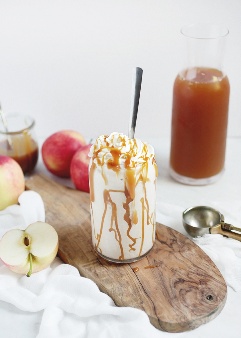 white milkshake in a glass with caramel drizzle