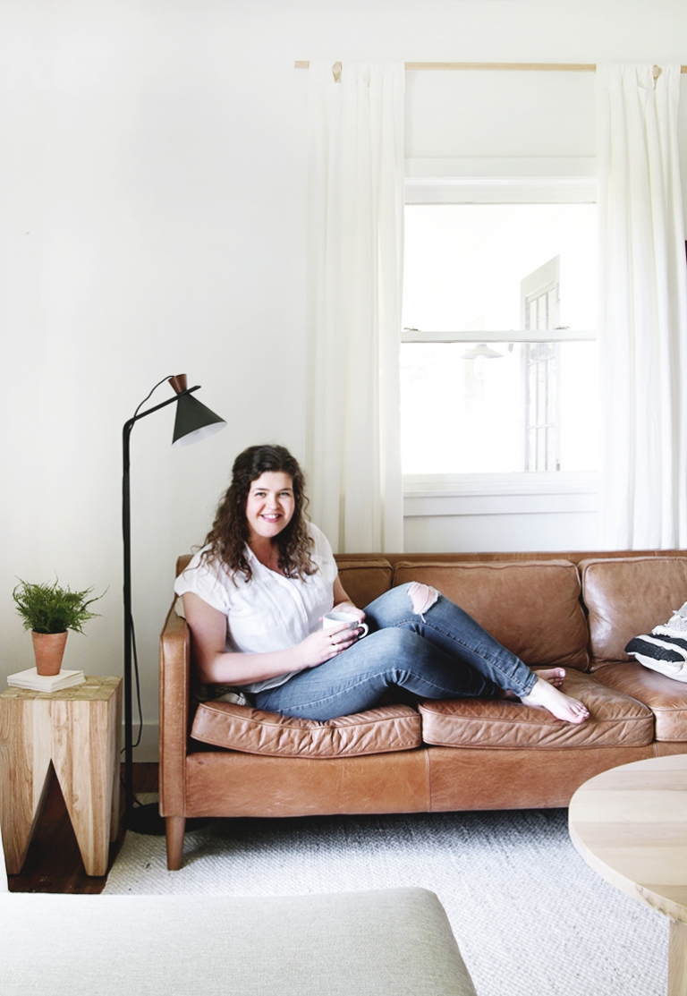 woman sitting on leather couch