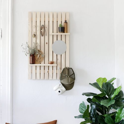 slat wall shelf with trinkets and small mirror