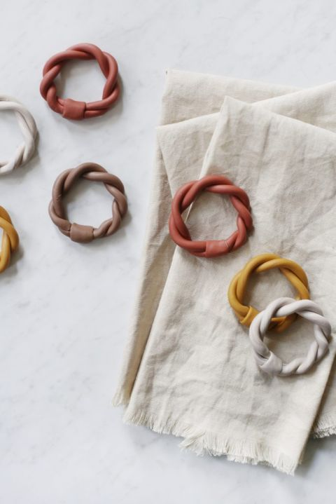 napkin rings on top of stack of fabric napkins