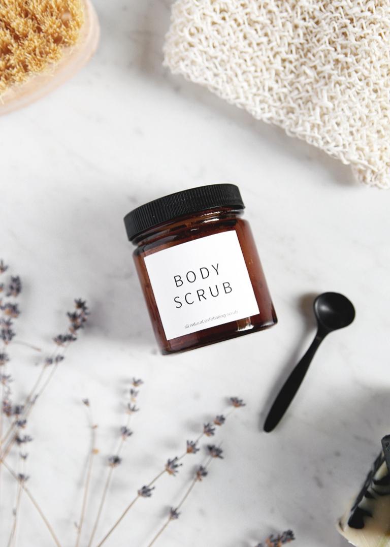 amber glass jar with white body scrub