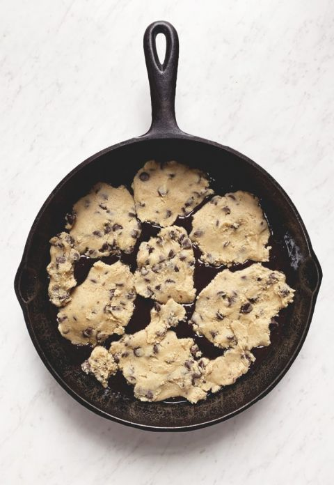 uncooked brownie batter and cookie in cast iron skillet