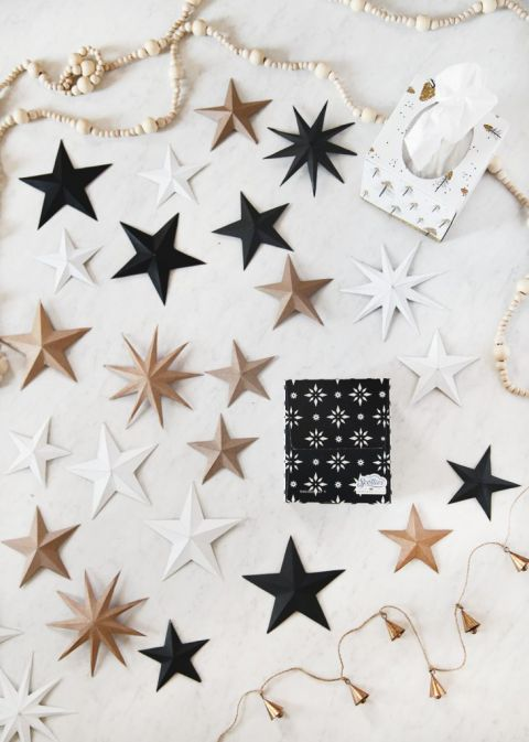 black, white, and natural 3D cardboard stars next to tissue boxes