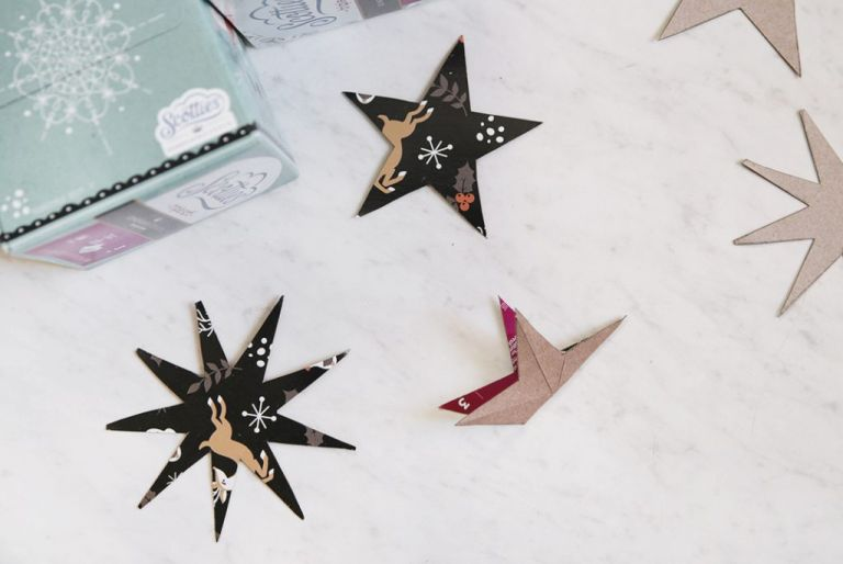 cardboard star cutouts with one star folded in half