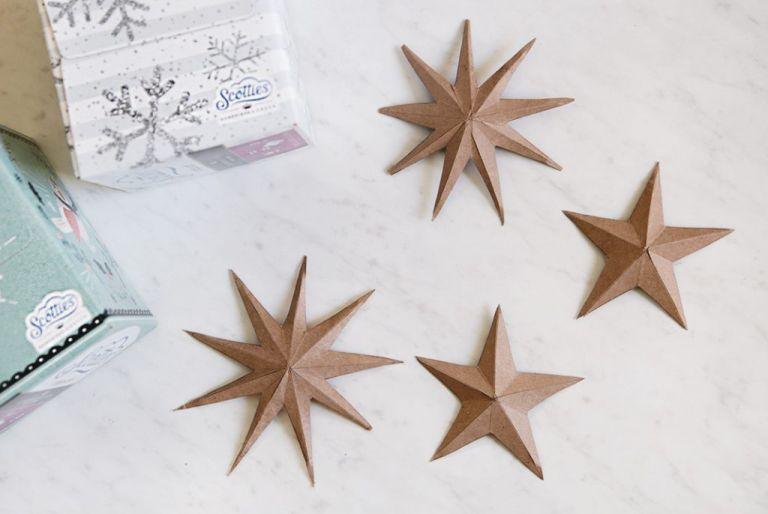 3d cardboard stars next to tissue boxes