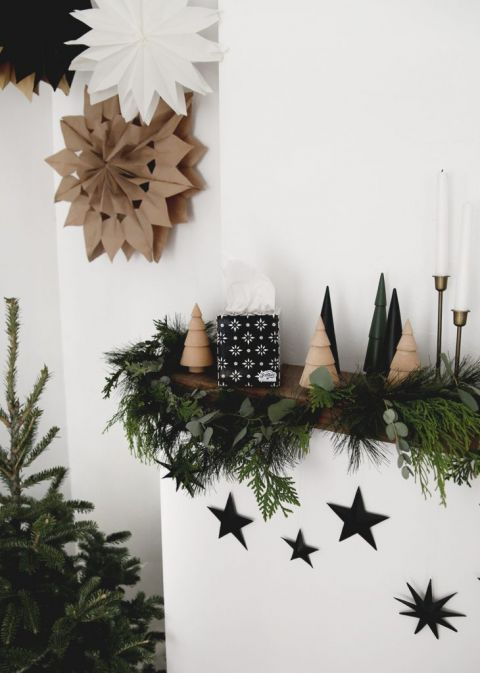 mantel with holiday decor and star decorations