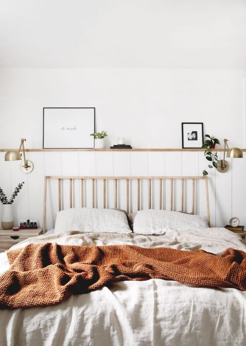 bed with dowel headboard with shelf above bed