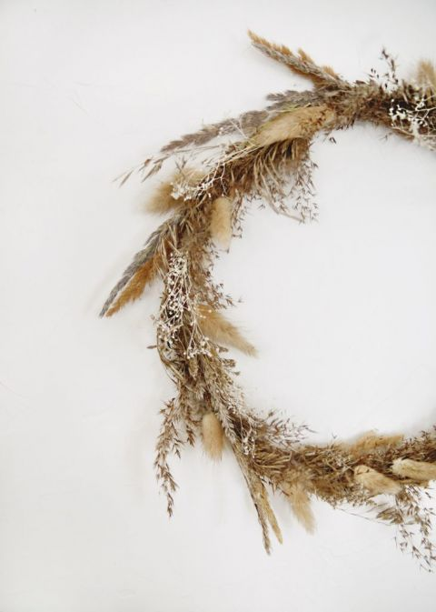 dried grass fall wreath on white wall