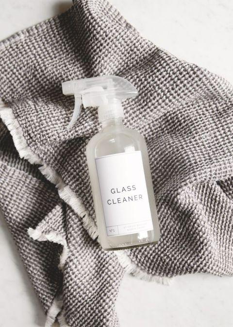 bottle of window cleaner on gray towel