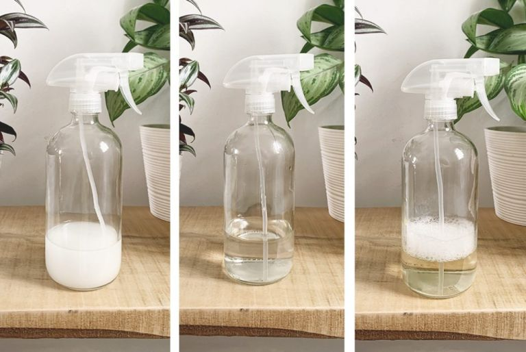 3 clear glass bottles filled with liquid on shelf