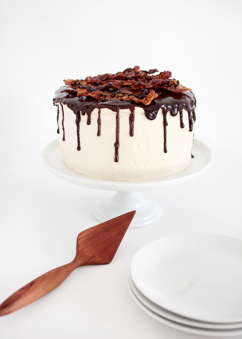 Christmas chocolate cake with maple icing and bacon
