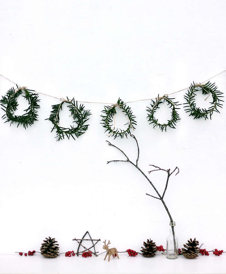 DIY Mini Wreath Garland | 50 Awesome DIY Yule Decorations and Craft Ideas You Can Make for the Winter Solstice