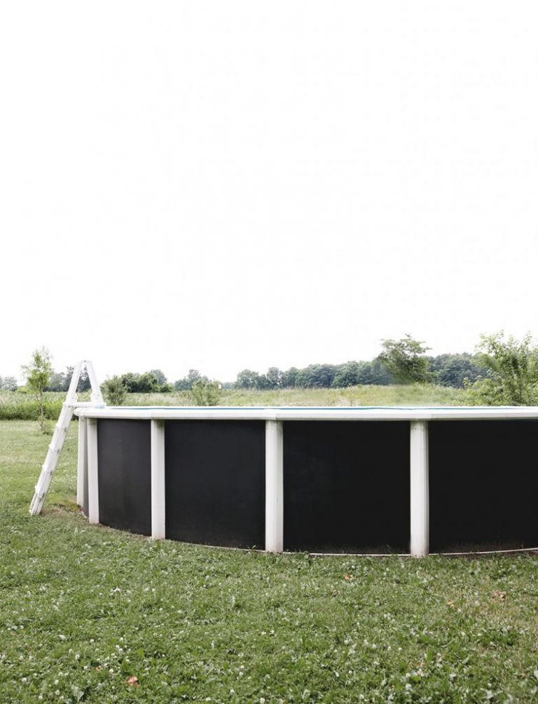 above ground swimming pool with painted black walls