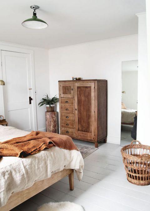 bedroom with wood dresser and basket