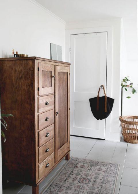 antique wood dresser in bedroom