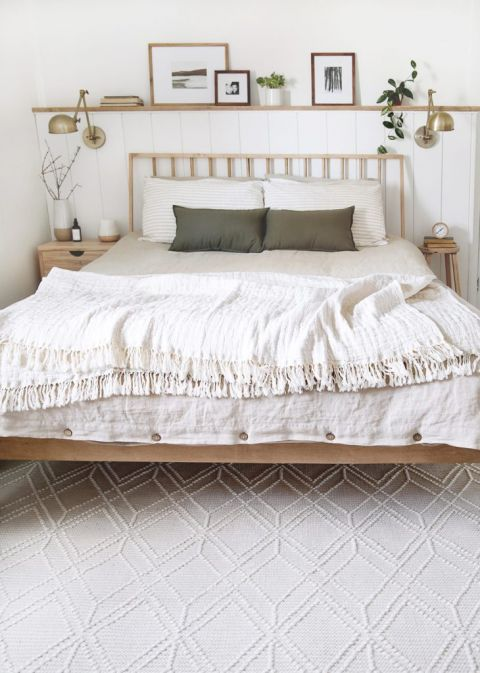 bedroom with wood bed and cream wool rug
