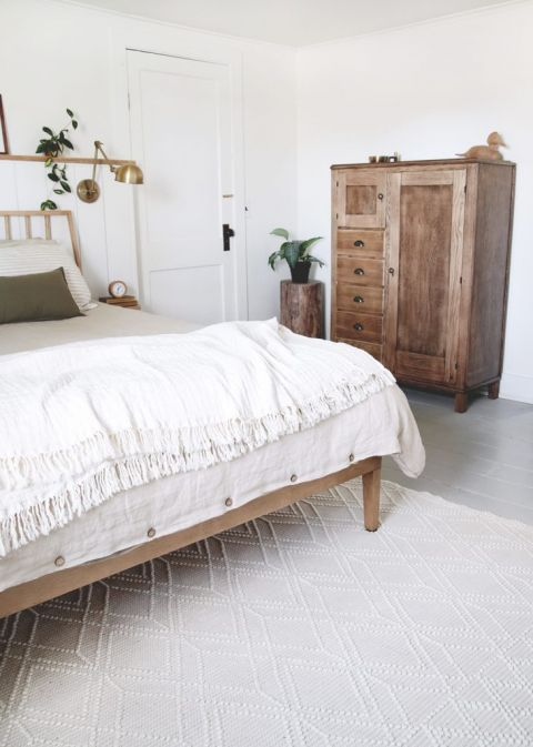 bedroom with creamy wool rug and antique dresser