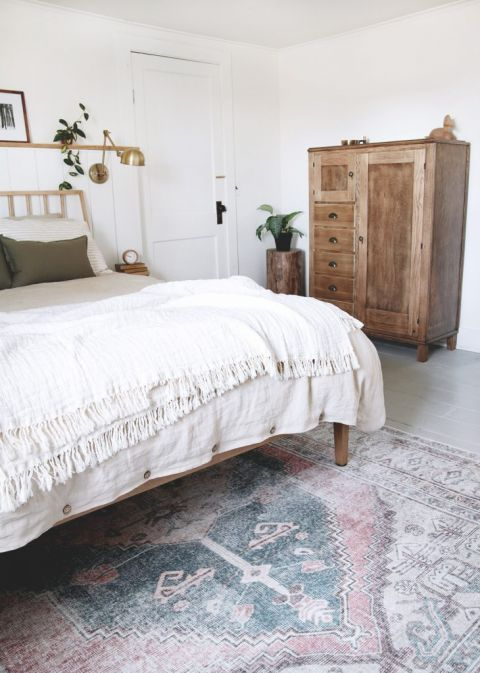 bedroom with neutral area rug and antique dresser