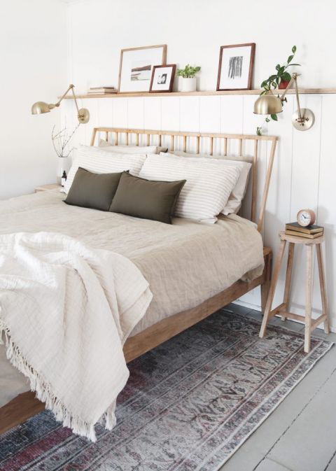 bedroom with wood bed frame and wood shelf above bed