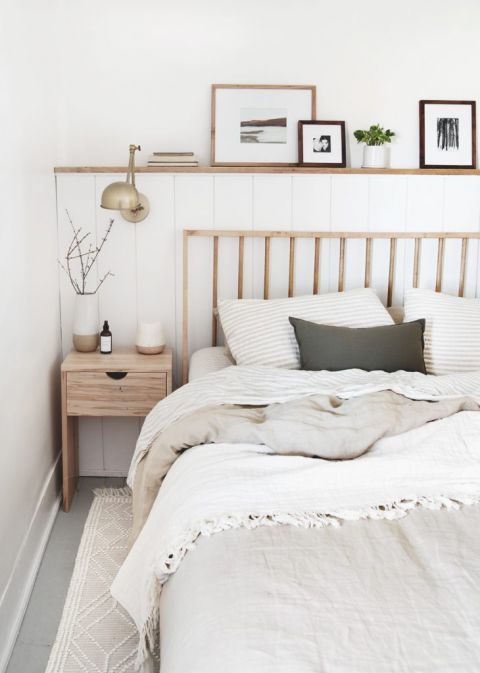 wood dowel bed next to wood nighstand